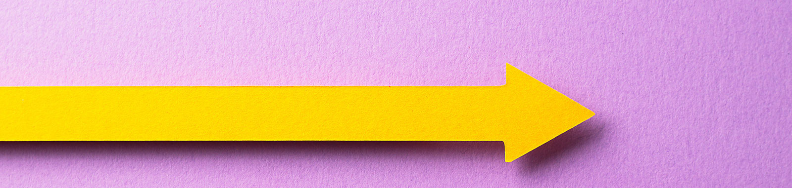 Yellow arrow on a purple background